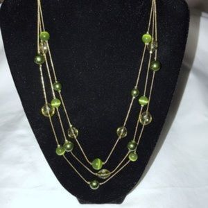 Gold tone triple strand necklace w/green beads
